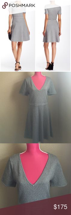 """Trina Turk Textured Sweater Dress Laila grey heather fit and flare dress. Approx. 37"""" length. Slip on over neck. V-neck. Short sleeves. XL-14. 72% viscose, 28% poly. Unlined. Offers welcome through offer tab. No trades. 10902161331 Trina Turk Dresses Mini"""