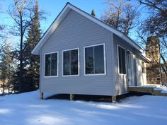 This 4 season porch addition increased the amount of livable space at this cabin