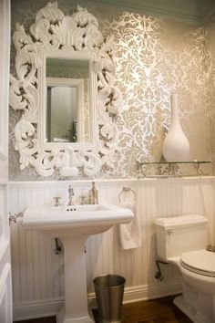 Love the mirror & the damask wallpaper