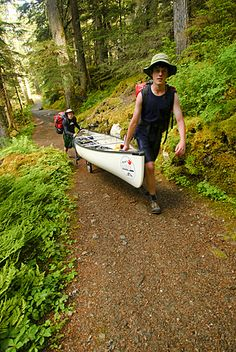 Canada - Boy Scouts canoeing on the Bowron Lakes circuit. Bowron Lakes Provincial Park. Quesnel, British Columbia