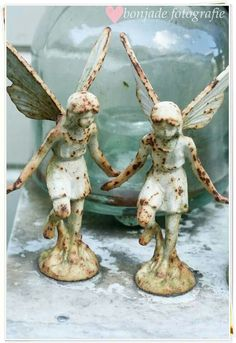 Aged angel statues