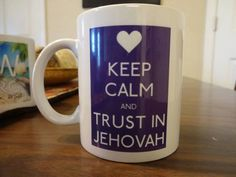 """This mug makes a wonderful gift or conversation starter! Mug reads Keep Calm and Trust in Jehovah in purple. Ceramic tea/coffee mug printed on two sides. 11-oz, 3.8"""" high x 3.2"""" diameter Microwave and dishwasher safe White, Glossy  Price is $15.00+shipping , there is no handling charge.  This item is professionally printed & heat pressed in my home studio. Print will not wash off.  Many more designs coming soon"""