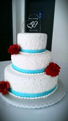 Spring wedding teal and bright red sugar roses! :))