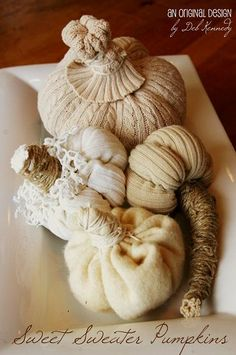 It's fall, I do love all things pumpkin. These are nifty little pumpkins made from old sweaters and twine.