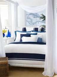 Although this bedroom uses only two colors of white and navy, interest is added by using multiple layers of the two colors.