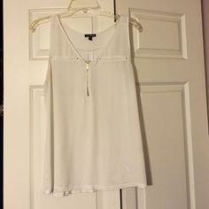 White tank top with 4 studs White dressy tank top. Silky feel in the front with 4 studs and cotton back Express Tops Tank Tops