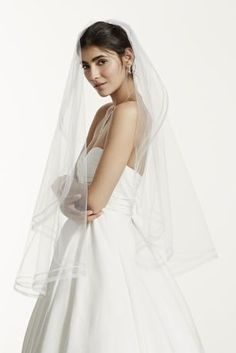 """This one tier mid length vapor veil will compliment an wedding gown for a perfect look!  One tier mid length veil features faux horse hair edge for a stunning effect.  Tier measures 40 1/2"""" in length.  To care for your veil, hang and steam.  Imported."""