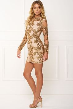 Features rose gold floral sequin design scattered on mesh fabric with a sheer long sleeve high neck style midi length dress. We're thinking pointed heels and a statement earrings to make this outfit full of class! This dress is made from our signature luxurious bandage material with a lace style overlay. • Sexy Celeb look hugging style • Mini dress style • High neckline dress - fully lined • Sheer long sleeve • Featuring rose gold floral design • Visible Zipper up back • Please note this…
