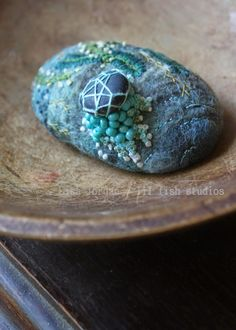 lil fish studios: skipping stone. Felted and embroidered stone by Lisa Jordan