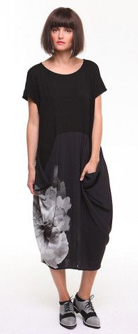 Supersized floral highlighting longer length easy fit dress with stylized pockets