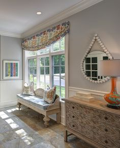 Beaded white mirror is from Go Home.