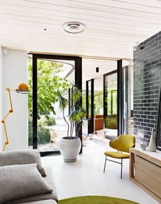 Modern living room with glazed brick wall