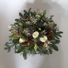A natural scented foliage filled seasonal arrangement in a container. Some Roses, Hyacinths and Succulents are included . Christmas Flowers, Christmas Wreaths, Christmas Arrangements, Table Centers, Succulents, Bouquet, Container, Roses, Seasons