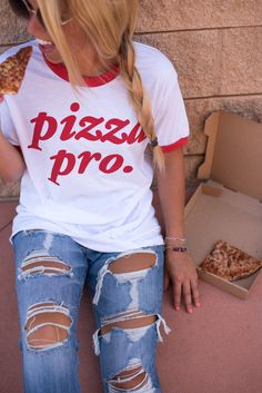 Pizza Pro ringer t-shirt. This trendy graphic t-shirt is one of the newest additions to our Say What?! line, a collaboration with a local vendor. Lush Fashion Lounge women's boutique is known to carry