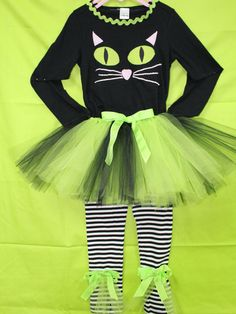 Your little girl would look adorable in this 3 piece set for a Halloween party or get together. Long sleeve black t shirt trimmed in lime green rick rack and a large cat face. The matching tutu is made out of lime green and black tulle. The matching leggings are black and white stripe with lime green tulle and lime green bows at each ankle. The outfit can be worn with out the tutu if desired. | Shop this product here: http://spreesy.com/DollyWollySewing/18 | Shop all of our products at…
