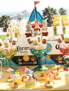 Jimmy Buffet Party - Sand bars made with rice cereal bar, gummy cheeseburger sitting under umbrella displayed on a shovel.. What the what?!? Lol.. Yes please!!