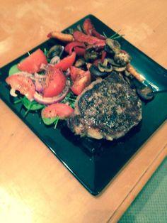 Peppered scotch fillet with sautéed mushrooms  a garden salad