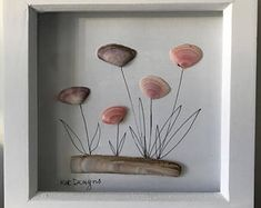 Pebble and shell art picture of pink and mauve flowers in a white glazed square box frame Easy Flower Painting, Seashell Painting, Rock Painting Ideas Easy, Seashell Art, Seashell Crafts, Pebble Painting, Sea Crafts, Sea Glass Crafts, Sea Glass Art