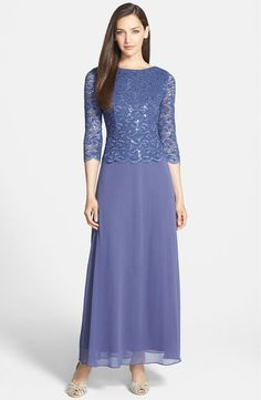 Look pretty in periwinkle when it matters most. Romantic evening gown with soft full-length periwinkle skirt and matching lace top. Metallic detailing in top shimmers through the scalloped lace. Perfe