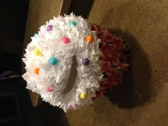 Paige's cupcake valentine box! Plastic flower pot bottom, covered with folded wrapping paper. Paper lantern top covered with tissue paper puffs and glitter sprinkles!