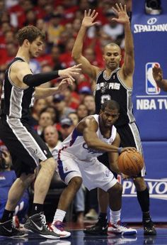 Tiago Splitter and Tony Parker defend Chris Paul in Game 4