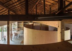 Traditional Japanese house updated with a curved plywood interior.