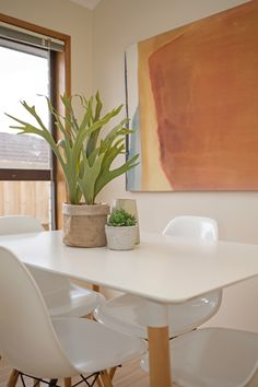 eames dining setting, succulents in pot, faux plant, orange canvas