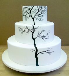that's kinda cool. painted tree wedding cake - this would be cool with like a teal/blue ombre thing going on in the background!
