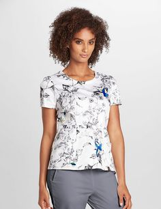 The Peplum Top in Spring Meadow is a contemporary addition to women's medical scrub outfits. Shop Jaanuu for scrubs, lab coats and other medical apparel.