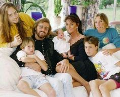 BARRY GIBB AND HIS FAMILY. You can definitely see some reappearances of the Gibb image in his lovely offspring!