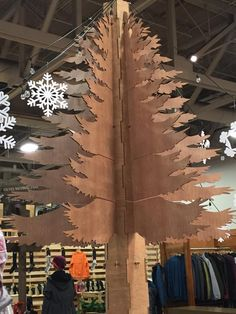 White Sierra Tree - made of falcon board - it stands 18ft high and is completely strong with no glue or nails just good engineering! #thinkoutside #whitesierra #IVEY #tree #falconboard #findyouroutdoors #outdoorretailer #setdesign www.whitesierra.com