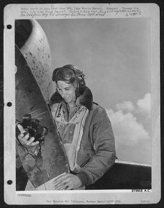 Lt. Ellis Wallenberg, a 73rd Fighter Squadron, 318th Fighter Group, 7th Air Force P-47 pilot, examines the prop of his plane after returning to Ryuku Retto. A 20mm cannon shell from a Japanese fighter pierced the prop blade but didn't damage anything else.