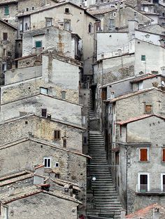 A Street in Scanno, Abruzzo italy, check out the stairs.  Would love to see the inside of one of these homes.