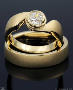 Check out Krikawa's collection of unique wedding and engagement ring designs. Each ring is made-to-order in your favorite metals and stones!