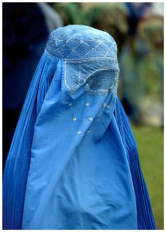 Any woman who takes off her clothes in other than her husband's home, has broken Allah's shield upon her.""