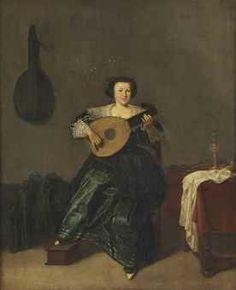 Dirck Hals (Haarlem 1591-1656) An elegant lady in a green dress playing a lute in an interior