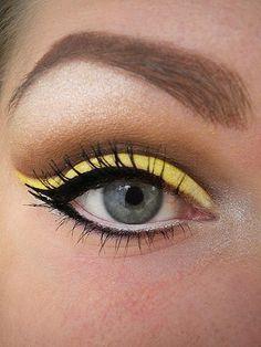 Yellow eyeshadow, white eyeliner