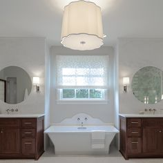 Beckwith Interiors   Large Simple Scallop Chandelier by Barbara Barry: BBL5015....marble backsplash behind tub