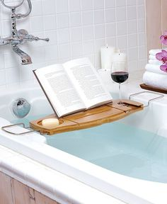 Relax in the bath with confidence, with this Aquala bathtub caddy from Umbra. Made from bamboo, this caddy will not split or mould when used over warm water. With a space for everything, including a book rest and a drink holder, this bathtub caddy is a Howard Storage, Bathtub Caddy, Bathtub Tray, Bathtub Shelf, Bathroom Caddy, Bathroom Ideas, Modern Bathroom, Bath Trays, Bathtub Pillow