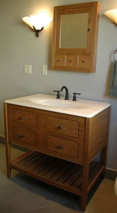 double height apron, open style vanity with a slat shelf, stained with a Nutmeg finish.