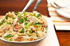 Artichoke Lemon & Chicken Pasta Recipe Main Dishes with spaghetti, bacon, chicken breast halves, all-purpose flour, salt, pepper, artichoke hearts, capers, white wine, chicken broth, fresh lemon juice, heavy cream, butter, fresh parsley