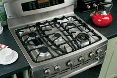 Cleaning stove burner grates: In a dishpan, soak them in 1 gallon warm water and 1/2 cup baking soda for 30 minutes.  Rinse and dry.