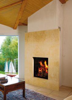 Cheminée avec parement en pierre du Gard, foyer Ruegg Lumo