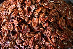 My mother doesn't like to cook. To compensate, she loves any trick that allows her to produce impressive results with minimal effort.Her bag of tricks holds ice cream pie, anything with bacon, and these killer candied pecans that transform the simplest salad into a pricey restaurant specialty.