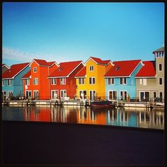 Coloured harbour houses at clear sky #groningen #reitdiep #netherlands #holland