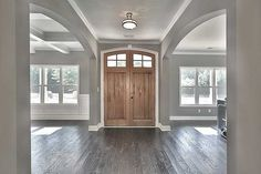 Plan Bright and Airy Craftsman House Plan Beautiful foyer with hardwood floors, white trim and moldings, grey walls, large statement entry door, coffered ceiling and lots of windows. House Design, House, Home, Building A House, Grey Walls, House Plans, New Homes, House Interior, Craftsman House