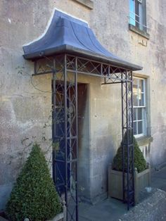 Wrought iron and lead porch Colerne High Street