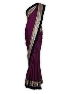 Featuring this beautiful Wine Crepe Sari in our wide range of Saris. Grab yourself one. Now!
