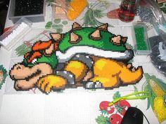 Bowser perler beads by ndbigdi on deviantart Hama Mario, Pearler Beads, Fuse Beads, Hama Beads Patterns, Beading Patterns, Pixel Art, Yoshi, Melty Bead Designs, Pixel Design