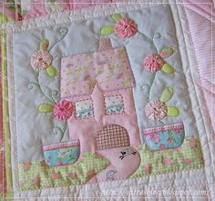 pastel house with yo-yo flowers  Perfect for a baby..or center of a larger quilt